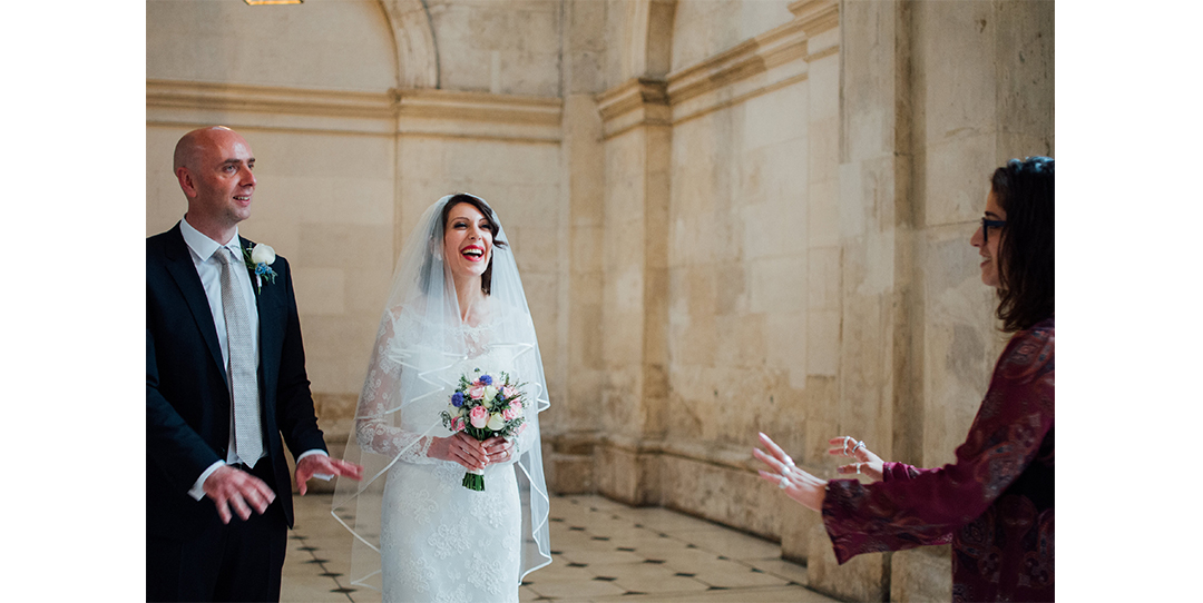 Bride laughing with guest at City Hall, Dublin